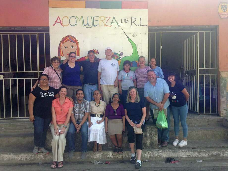 Meghan Piatak (back top row second from left and Maureen Anderson (front row far right, are currently in El Salvador on a U.S. Delegation trip as part of professional development at St Joseph High Photo: Contributed Photo