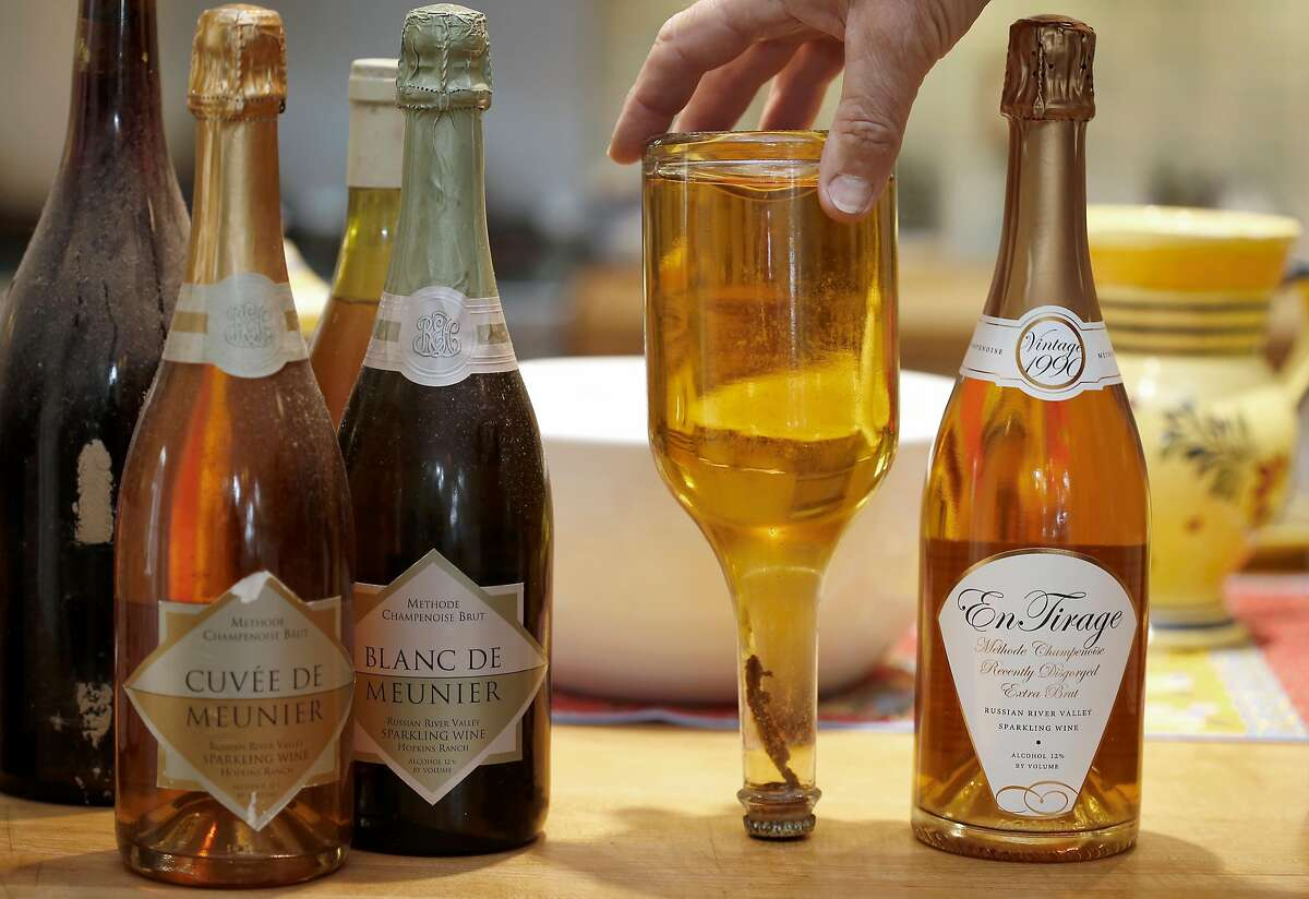 Bottles of sparkling wine from Don and Kay Baumhefner. Don holds his first bottle upside down.