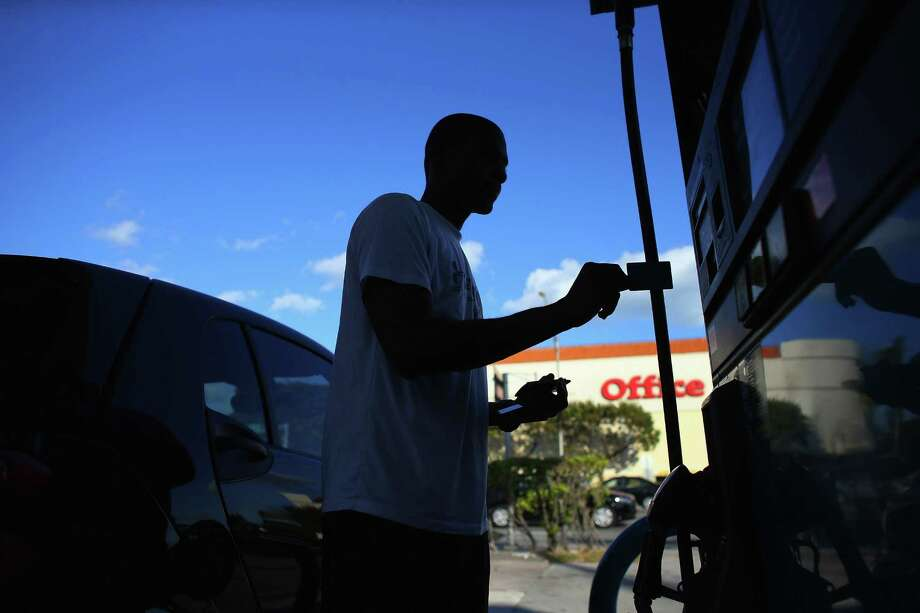 Merchants will have until October 2020 to install new chip-card readers at gas pumps. Photo: Joe Raedle, Getty Images / 2013 Getty Images