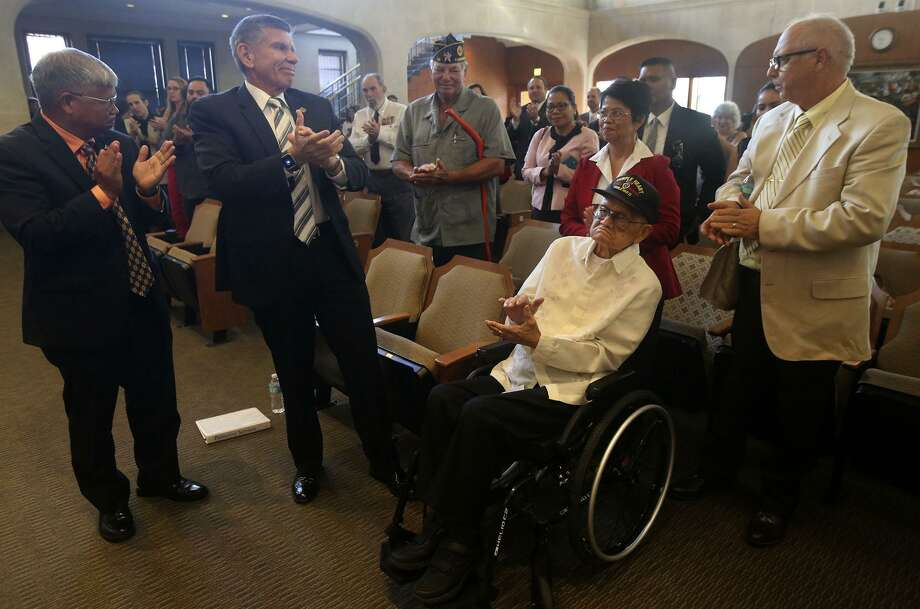 U.S. Army (Retired) Captain Dominador Soriano, age 100, (center, in wheelchair) is applauded Thursday October 13, 2016 at City Council Chambers during a brief presentation of a Resolution honoring Filipino and American veternans of World War II. Photo: John Davenport, Staff / San Antonio Express-News / ©San Antonio Express-News/John Davenport