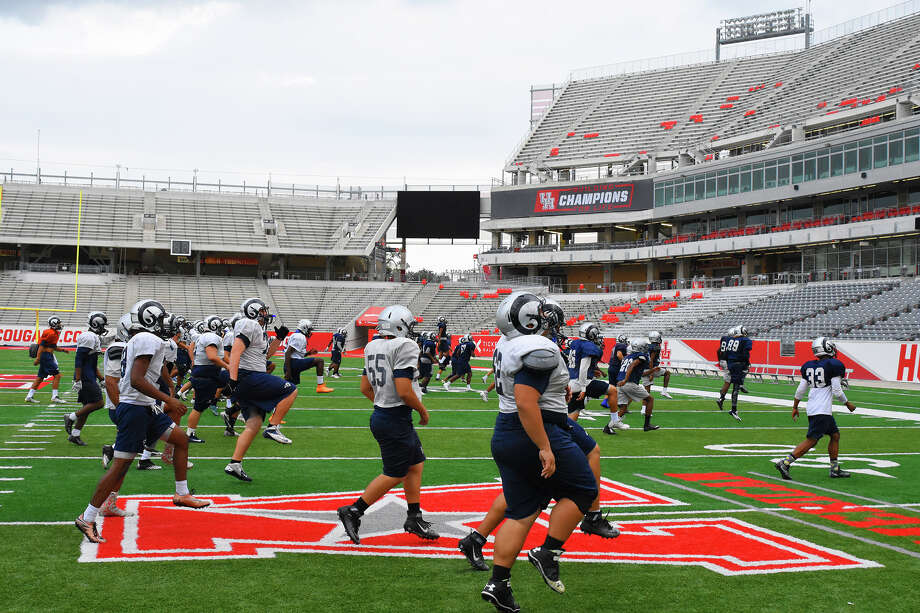 The Cy Ridge Rams take to the John O'Quinn Field Tuesday at the University of Houston's TDECU Stadium, in preparation for Saturday's Regional Finals matchup against Cinco Ranch. The two teams have met 10 times before, but never has Cy Ridge fielded such a complete, effective team. Photo: Tony Gaines / HCN