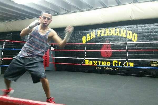 Joel Maldonado shadow boxes at San Fernando Gym in San Antonio in 2016.