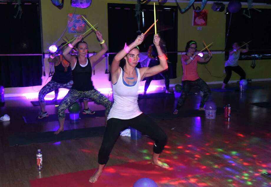 A blacklight rock band fitness class at The Good Karma Studio on Wednesday Oct. 26, 2016 in Albany, N.Y.  (Michael P. Farrell/Times Union) Photo: Michael P. Farrell / 20038527A