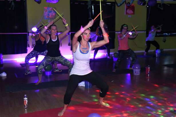 A blacklight rock band fitness class at The Good Karma Studio on Wednesday Oct. 26, 2016 in Albany, N.Y.  (Michael P. Farrell/Times Union)