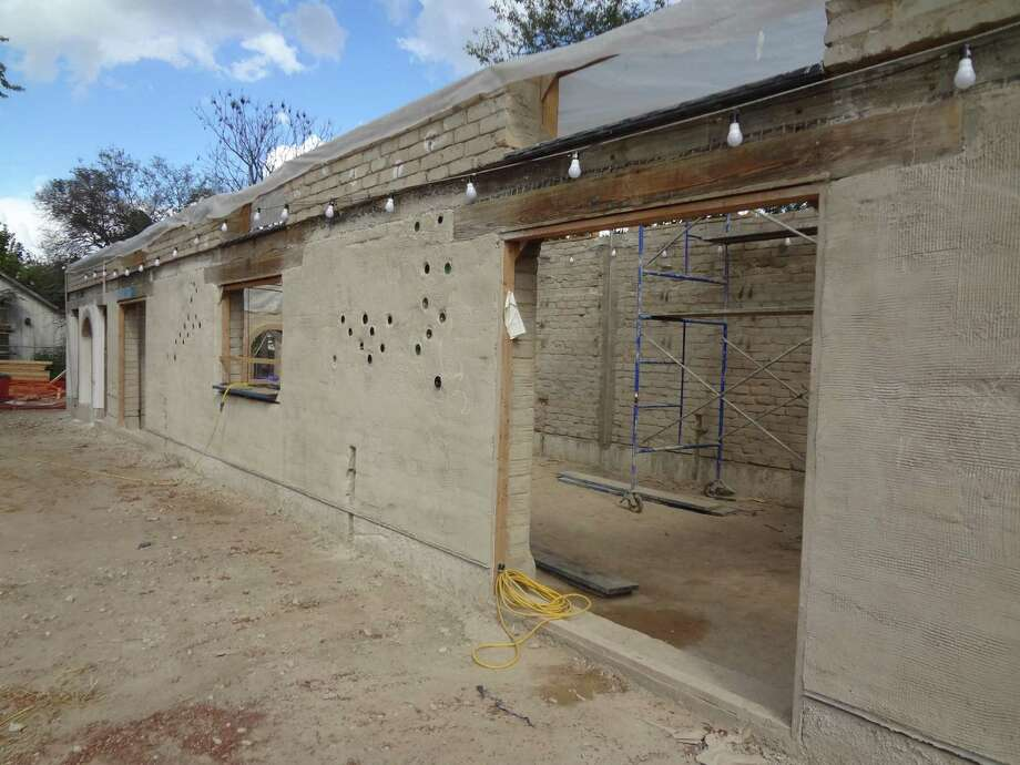 The MujerArtes studio at Esperanza's Rinconcito is being constructed of earthen bricks. The facade, which will be white with a lime/cactus juice plaster, will feature decorative tile murals depicting Aztec goddesses and has embedded glass bottles to let in light. Photo: Steve Bennett / San Antonio Express-News