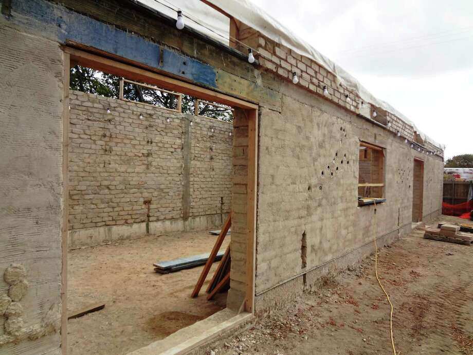 The facade of the MujerArtes studio, made of earthen bricks. Photo: Steve Bennett / San Antonio Express-News