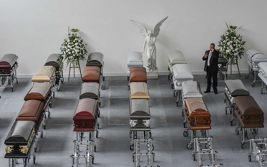 View of some coffins for players of the Brazilian football team Chapecoense Real at the Mortuary San Vicente in Medellin on November 30, 2016. Investigators worked Thursday to finish identifying 71 victims of a plane crash that wiped out a Brazilian football team in Colombia, left reeling by a harrowing recording of the pilot's final minutes without fuel.  Photo: LUIS ACOSTA/AFP/Getty Images