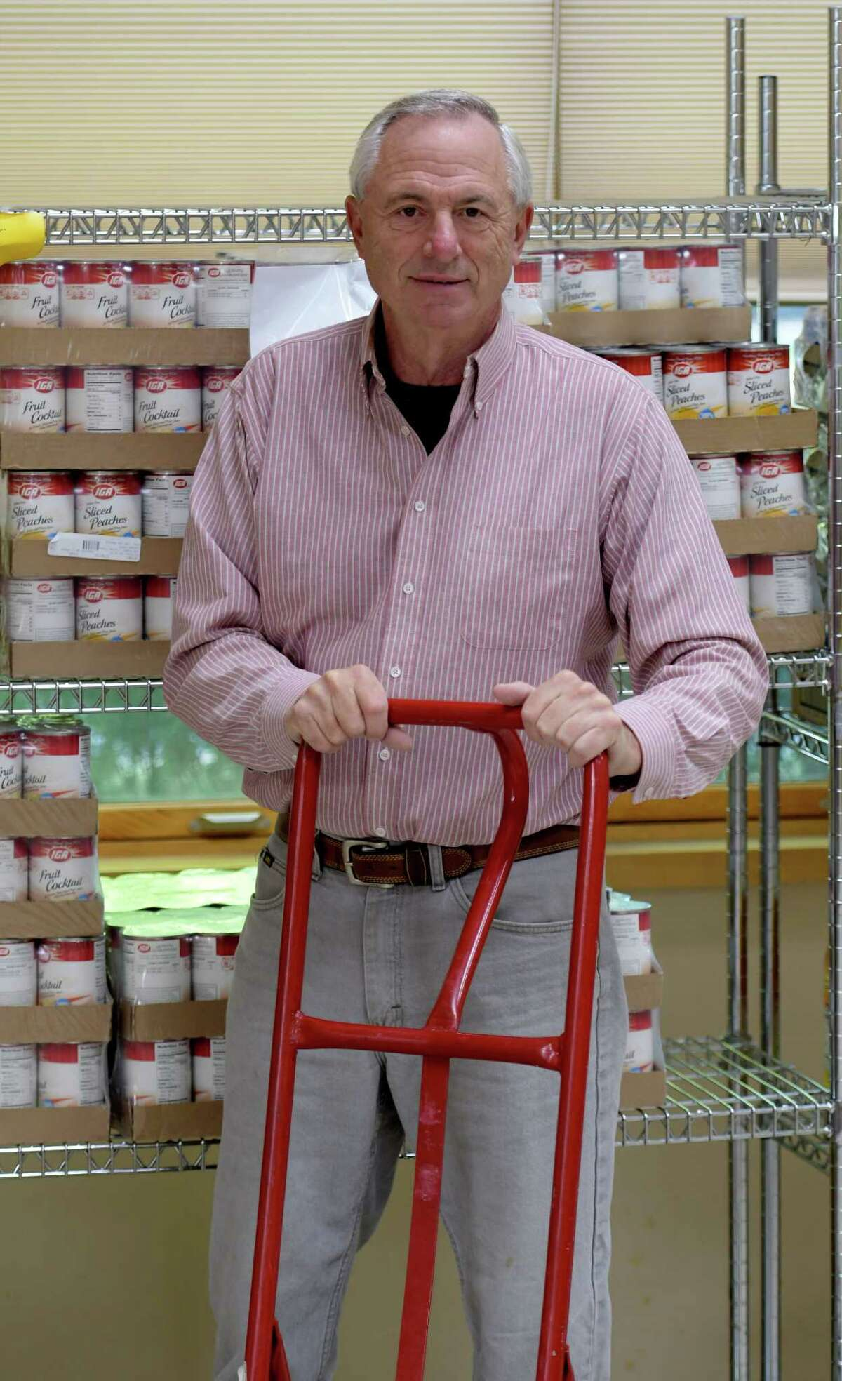 Bruce Sowalski unloads food at the St. Vincent's Parish Food Pantry Monday Sept. 26 2016 in Albany, N.Y. Sowalski died of COVID-19 in 2020. (Skip Dickstein/Times Union)