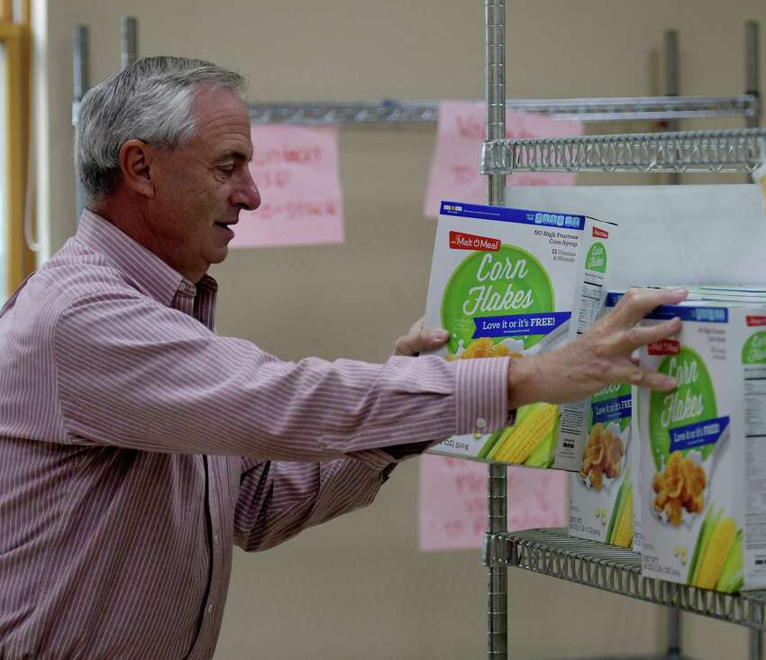 Bruce Sowalski unloads food at the St. Vincent's Parish Food Pantry Monday Sept. 26 2016 in Albany, N.Y. (Skip Dickstein/Times Union)