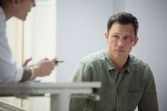 After a severe blow to the head, scam artist Charlie Haverford (Jeffrey Donovan) begins to see visions that make him wonder if he really is psychic and consults a doctor for some answers in 'Shut Eye' on Hulu.