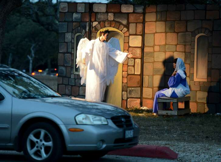 Actors reenact a scene from the story of the birth of Jesus as cars drive past during Concordia Lutheran Church's live, drive-through nativity event in 2012. The tradition started in 2004.