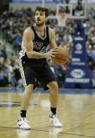 Spurs guard Nicolas Laprovittola looks to pass during the second half against the Mavericks in Dallas on Nov. 30, 2016.