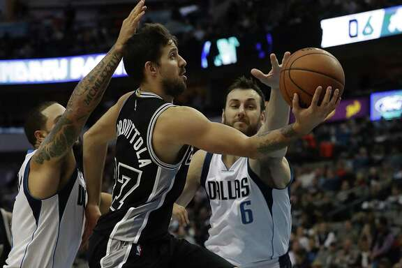 Nicolas Laprovittola of the Spurs takes a shot against Andrew Bogut of the Mavericks at American Airlines Center on Nov. 30, 2016 in Dallas.