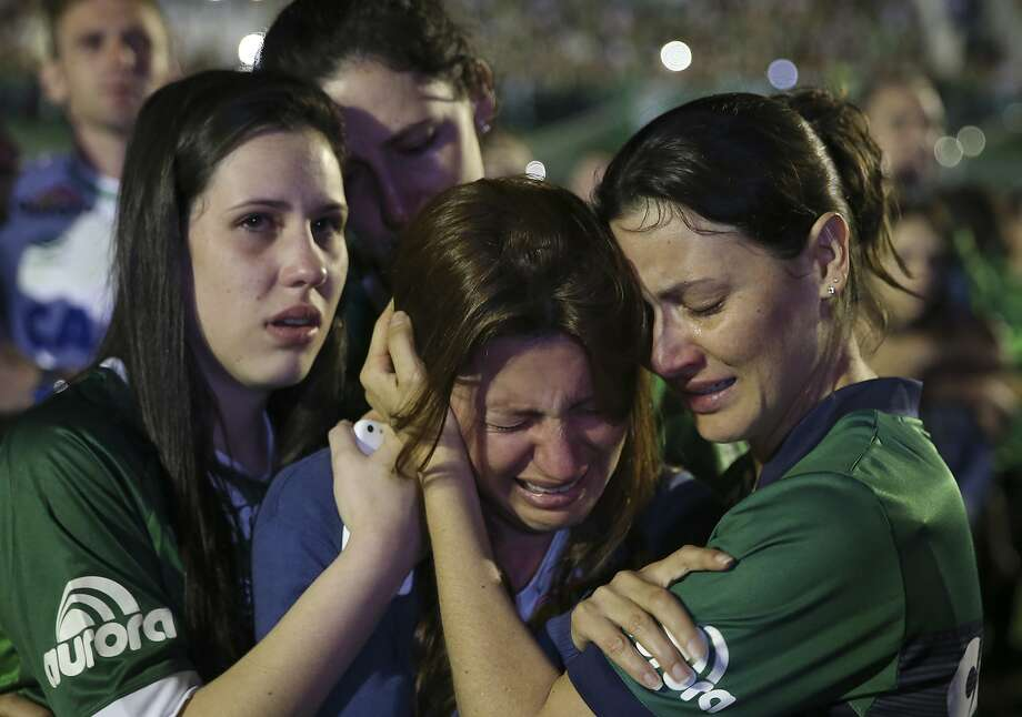 Relatives of Chapecoense soccer players, who died in a plane crash in Colombia, cry during a memorial inside a soccer stadium in Chapeco, Brazil. Photo: Andre Penner, Associated Press