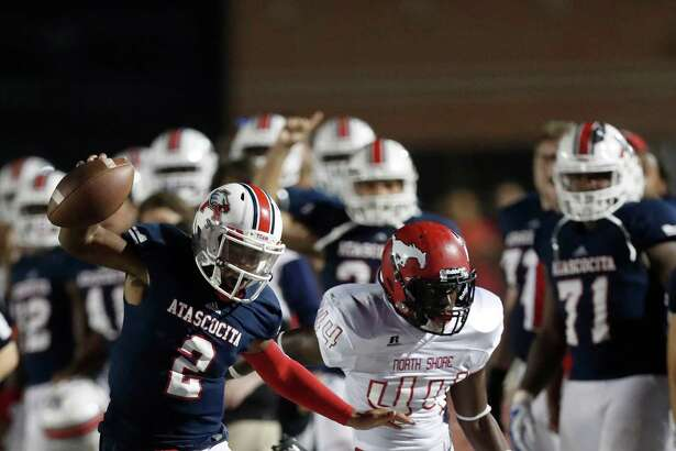 Atascocita's QB Daveon Boyd (2) stays inbound as he fought off North Shore's Jeremiah Qalter (44) during the second half of a high school football game at Turner Stadium, Friday, Oct. 7, 2016 in Humble.  ( Karen Warren / Houston Chronicle )