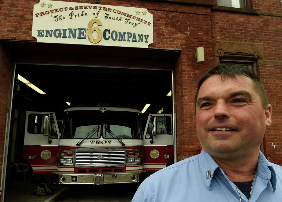 Retiring Captain Mike Spinelli stands beneath the sign that he made that hangs above the engine bay on Thursday, Dec. 1, 2016, at the Engine 6 quarters in Troy, N.Y. Spinelli retired on Thursday after 30 years with Troy Fire Department. (Skip Dickstein/Times Union) Photo: SKIP DICKSTEIN / 20039005A