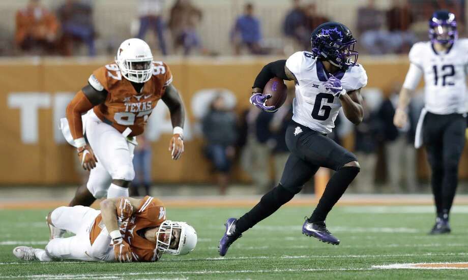 TCU running back Darius Anderson (6) breaks away from Texas safety Dylan Haines (14) during the second half of an NCAA college football game, Friday, Nov. 25, 2016, in Austin, Texas. TCU won 31-9. (AP Photo/Eric Gay) Photo: Eric Gay, STF / AP