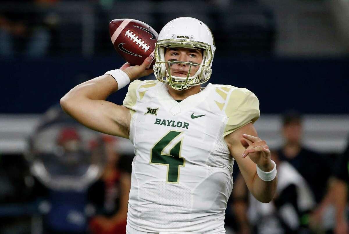 Baylor quarterback Zach Smith (4) throws against Texas Tech during the first half of an NCAA college football game Friday, Nov. 25, 2016, in Arlington, Texas. (AP Photo/Ron Jenkins)