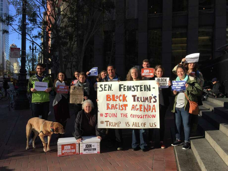 About 15 people gathered outside Sen. Dianne Feinstein's office in San Francisco to deliver a petition calling on Democrat congressional leaders to reject president-elect Donald Trump's cabinet appointees. Photo: Sarah Ravani / The Chronicle