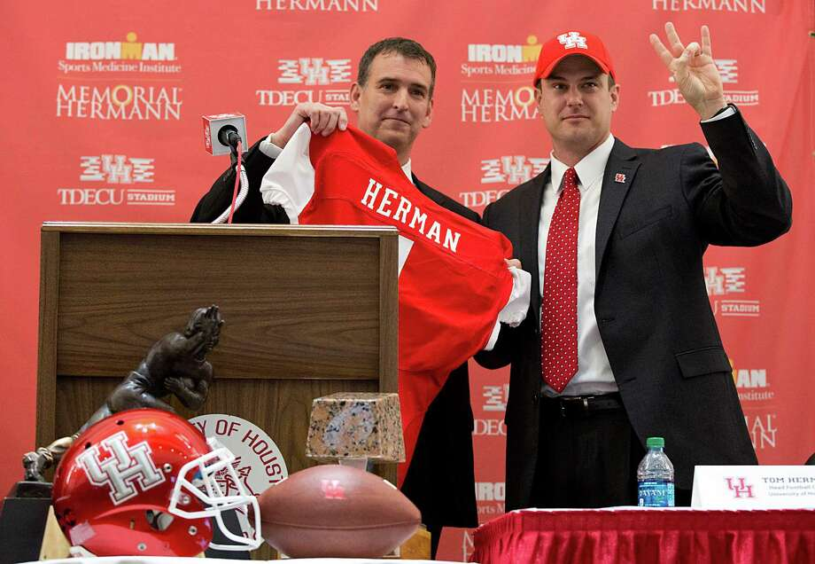 UH Athletic Director, Mack Rhoades introduces the new UH head football coach Tom Herman at the press conference on Friday, December 19, 2014 at TDECU Stadium at the University of Houston in Houston, Texas.  (Photo: Thomas B. Shea/For the Chronicle) Photo: Thomas B. Shea / © 2014 Thomas B. Shea