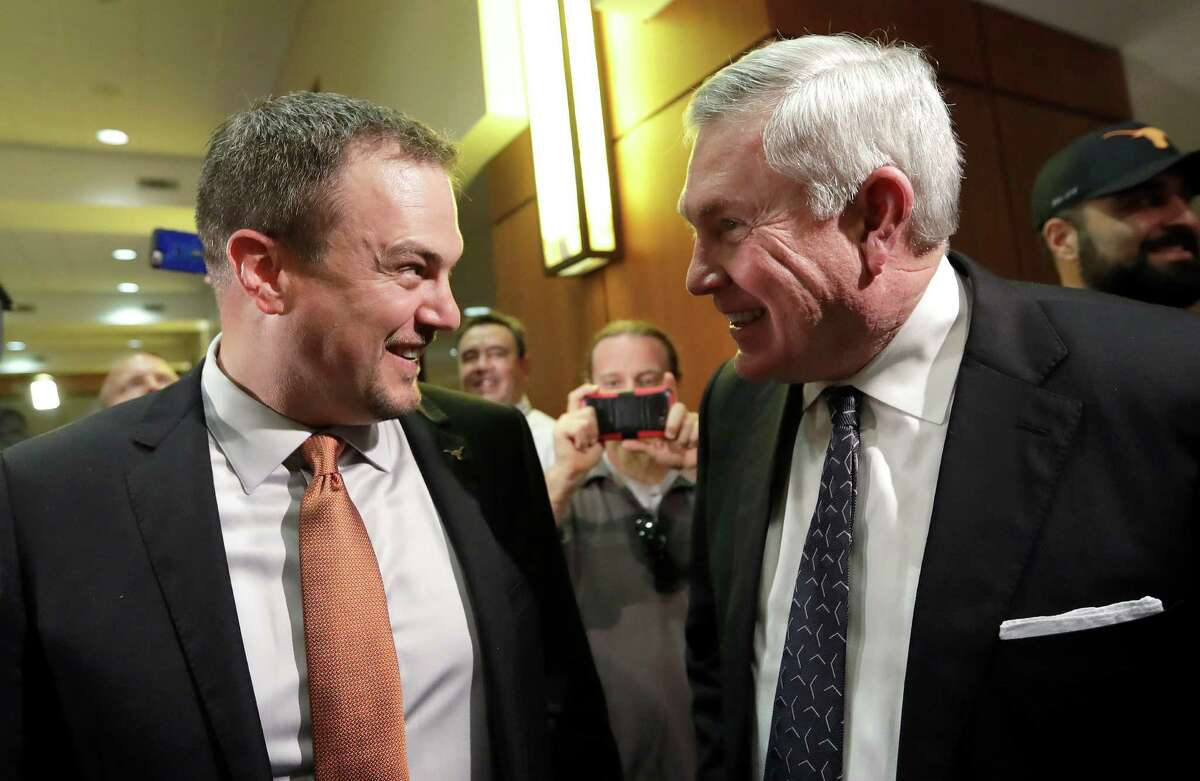 Texas hoped Tom Herman could restore the Longhorns to the heights that his former boss Mack Brown (right) took them, but his tenure ended with no conference championships in four seasons before being fired Saturday.