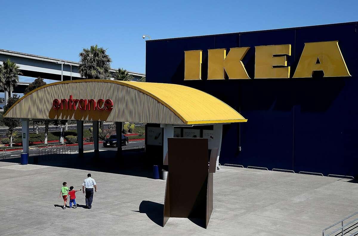Customers enter an IKEA store on June 26, 2014 in Emeryville, California.