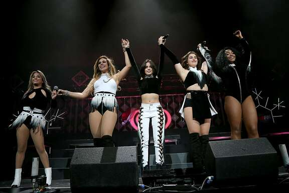 DALLAS, TEXAS - NOVEMBER 29:  (L - R) Ally Brooke, Dinah Jane Hansen, Camila Cabello, Lauren Jauregui and Normani Hamilton of Fifth Harmony perform in concert during the 106.1 KISS FM's Jingle Ball 2016 Presented by Capital One at American Airlines Center on November 29, 2016 in Dallas, Texas.  (Photo by Gary Miller/FilmMagic)