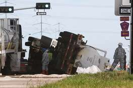 Authorities clean up hydrochloric acid that spilled from a truck that rolled over on the feeder road of Highway 225 eastbound, under Beltway 8, Thursday, Dec. 1, 2016, in Pasadena. ( Jon Shapley / Houston Chronicle )