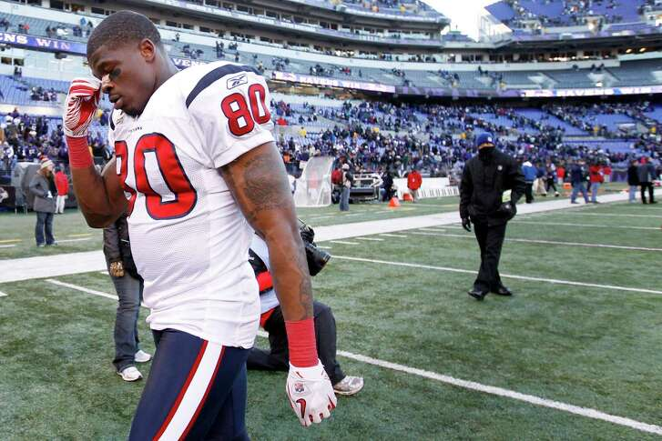 Houston Texans wide receiver Andre Johnson leaves the field following a 20-13 loss to the Baltimore Ravens in an AFC divisional playoff football game at M&T Bank Stadium on Sunday, Jan. 15, 2012, in Baltimore. ( Karen Warren / Houston Chronicle )