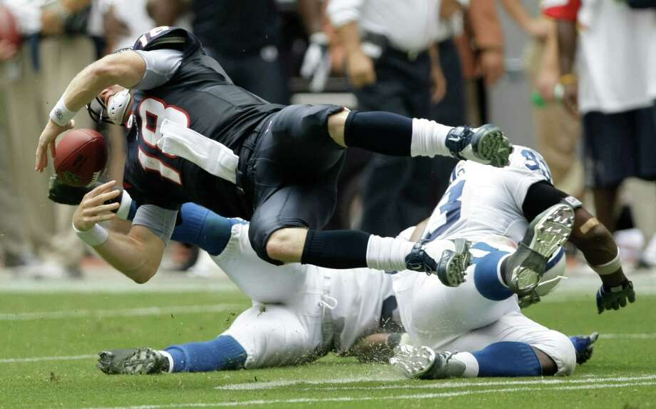 Houston Texans quarterback Sage Rosenfels (18) is hit by Indianapolis Colts defensive end Dwight Freeney (93) and Raheem Brock (79), forcing a fumble that resulted in a Gary Brackett return for a touchdown during the fourth quarter of an NFL football game at Reliant Stadium Sunday, Oct. 5, 2008, in Houston. The Colts came from behind to beat the Texans 31-27. ( Brett Coomer / Chronicle ) Photo: Brett Coomer, Staff / © 2008 Houston Chronicle