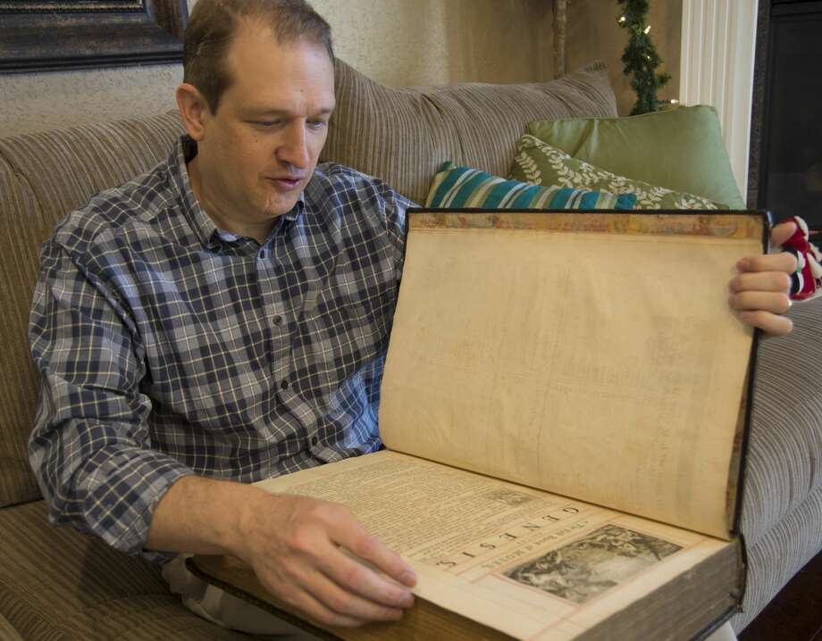 Chris Vore displays his King George II personal Bible, printed in 1753. Thursday 12-01-16  Tim Fischer/Reporter-Telegram Photo: Tim Fischer/Midland Reporter-Telegram