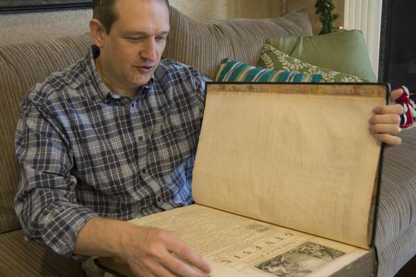 Chris Vore displays his King George II personal Bible, printed in 1753. Thursday 12-01-16  Tim Fischer/Reporter-Telegram