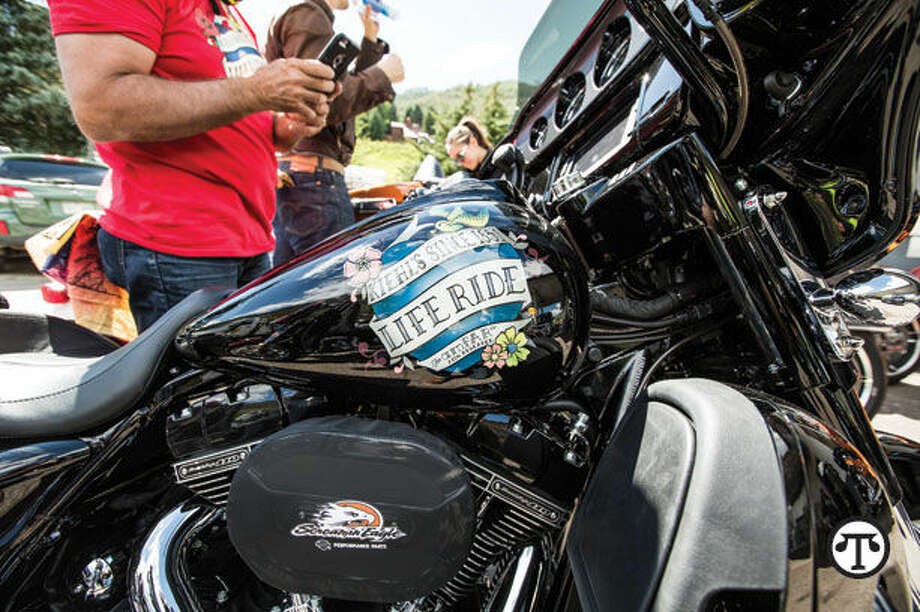Photo credit: Travis ShinnBikers, artists and hand salve users can all be part of an effort to end AIDS. (NAPS)