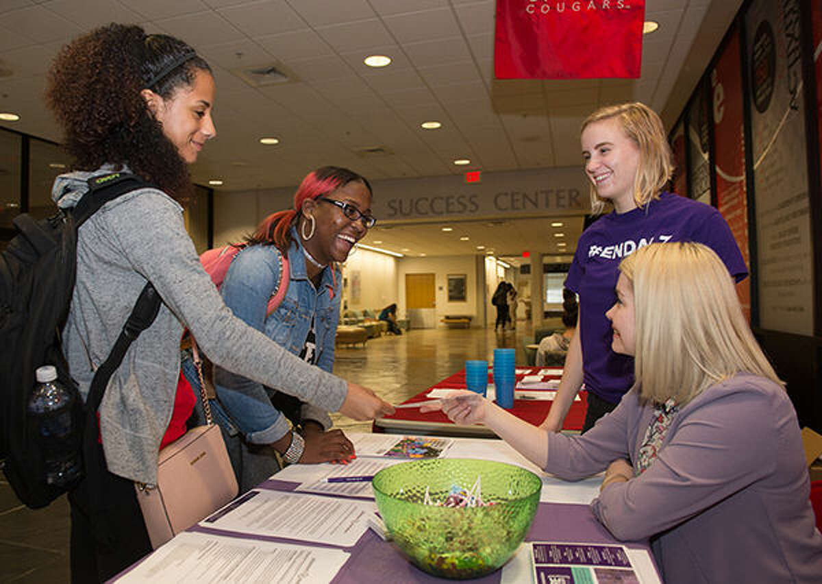Morgan Lowe, a junior accounting major from Belleville, and Chicago native Yaqkeha Witherspoon, a junior studying public health, visit with representatives from the Alzheimer's Association, including intern and SIUE student Emily Kaiser and SIUE alumna Lindy Noel.