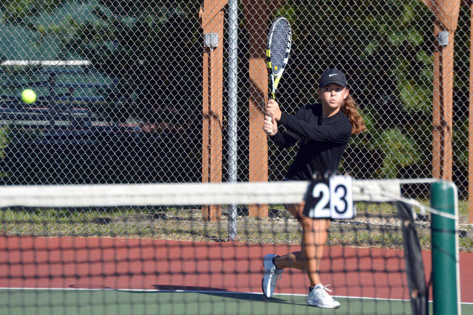 Edwardsville junior Grace Desse hits a backhand shot during action last season when she was a sophomore.