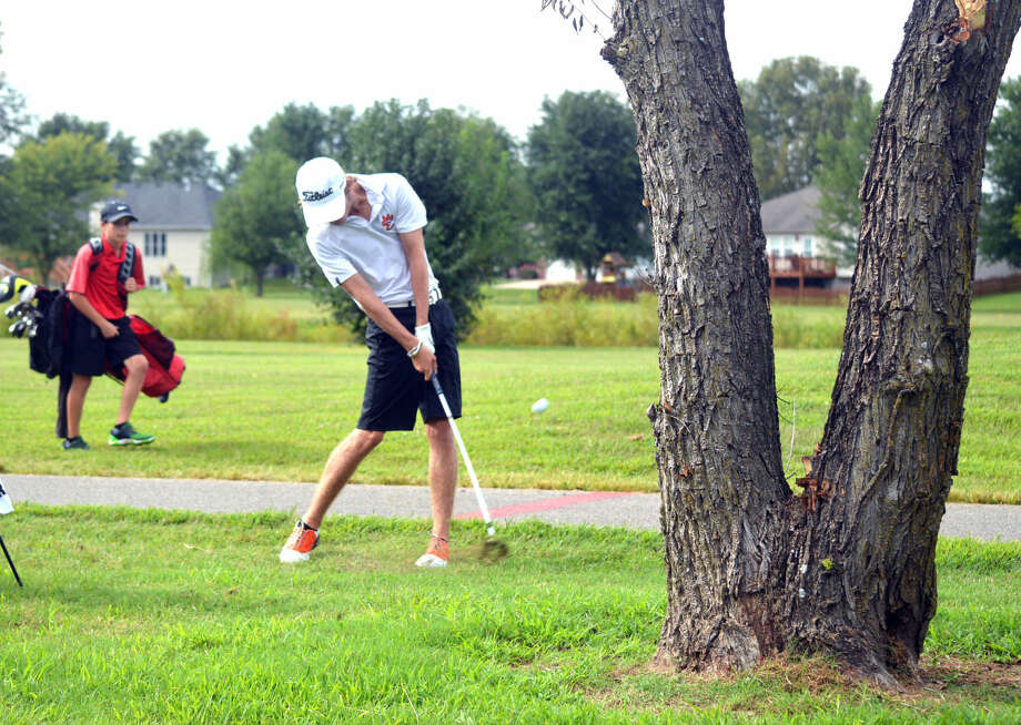 Edwardsville junior Tanner White hits his fourth shot on hole No. 1 at Legacy Golf Course during Wednesday's match against Granite City, Highland and Triad.