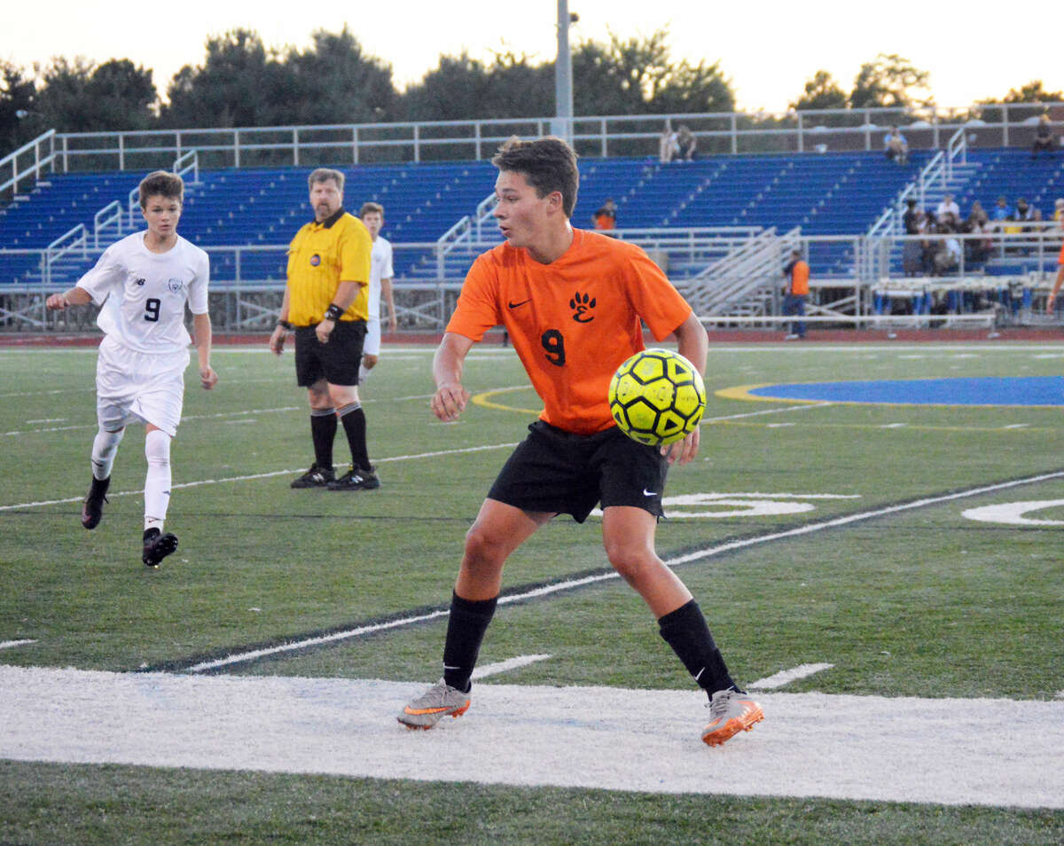 Edwardsville junior midfielder Kyle Wright prepares to play a ball at midfield late in the first half.