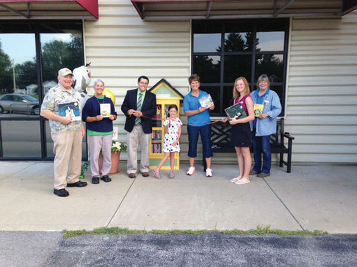 Pictured in front of the Little Free Library in Hamel are Don Kruckeberg, Denise Alexander, Hamel Elementary Principal Matthew Sidarous, Mina Cassens, Sandy Weinacht, Kayla Weinacht and Julie Nicols.