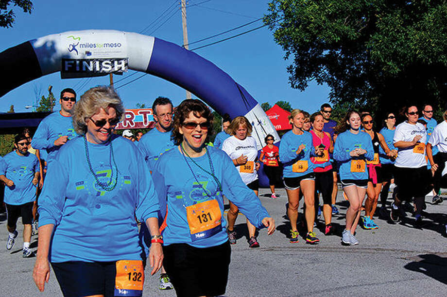 Participants in a previous Miles for Meso event begin their treks from the starting line.
