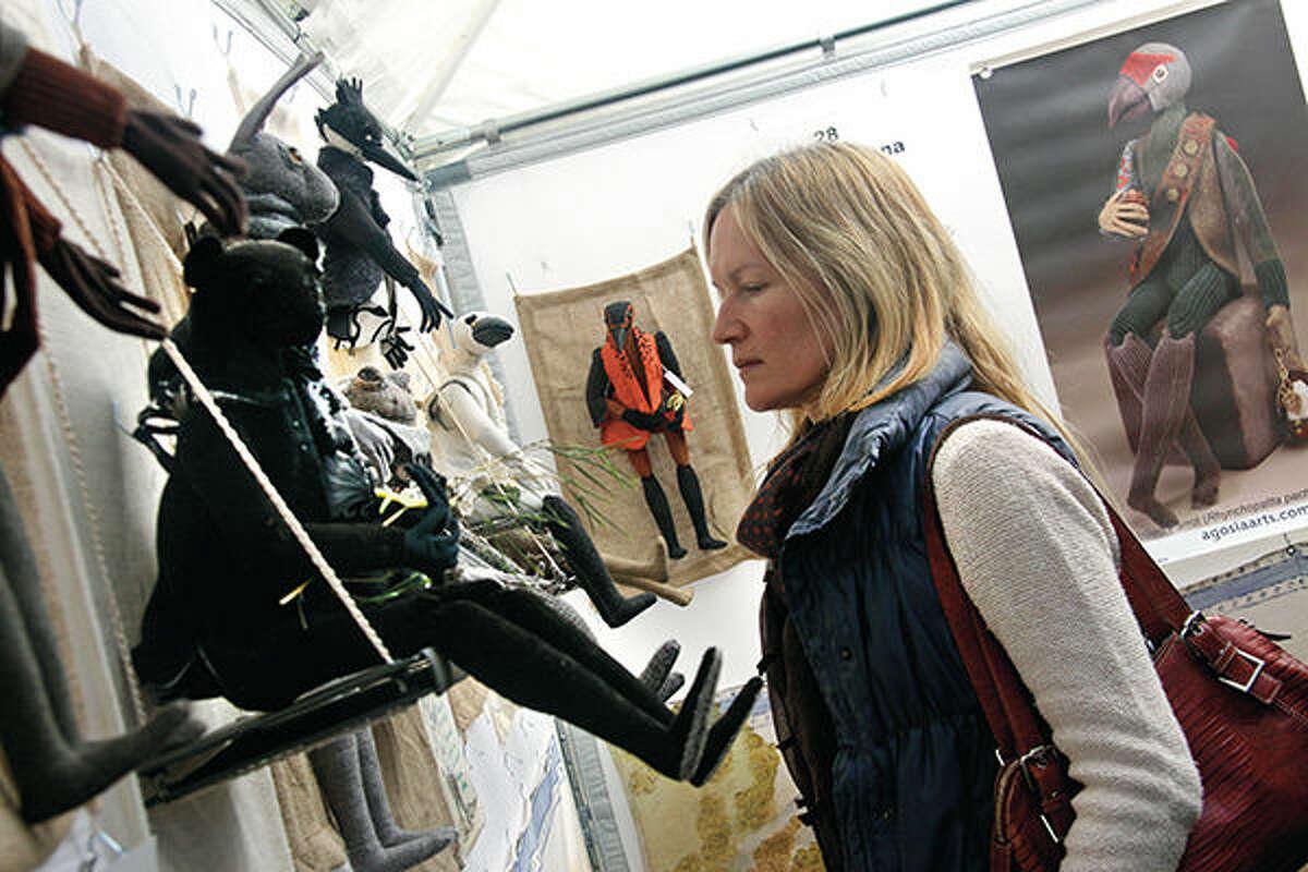 A shopper browses artwork at the 2014 Edwardsville Art Fair.