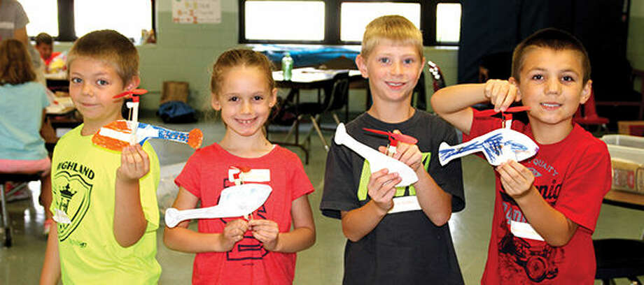 STEM Camp participants from around Madison County show off the helicopters they built.
