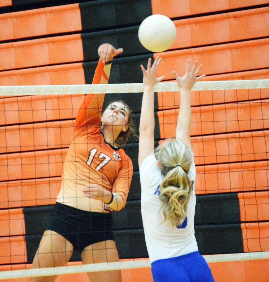 Edwardsville junior Rachel Pranger slams down a kill late in the first game.