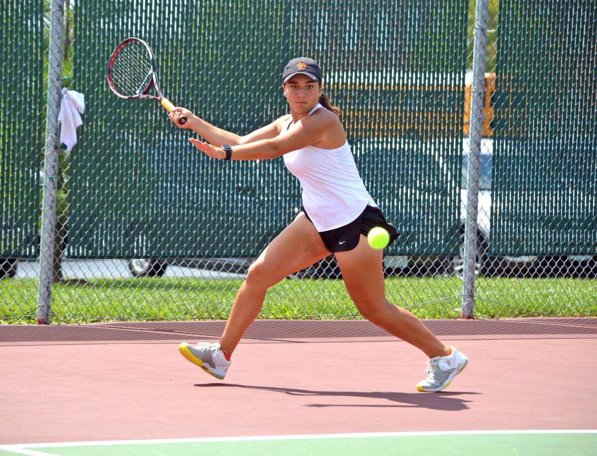 EHS sophomore Natalie Karibian makes a forehand return during her No. 1 singles match against Ellie Burger of St. Joseph's Academy.