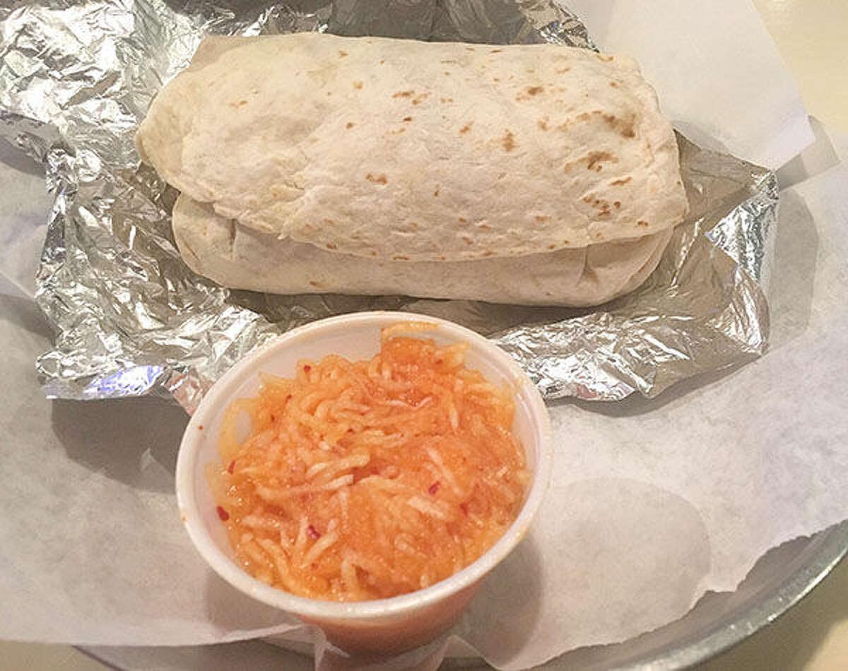 A burrito and the kimchi slaw at Seoul Taco located at 6665 Delmar Blvd.