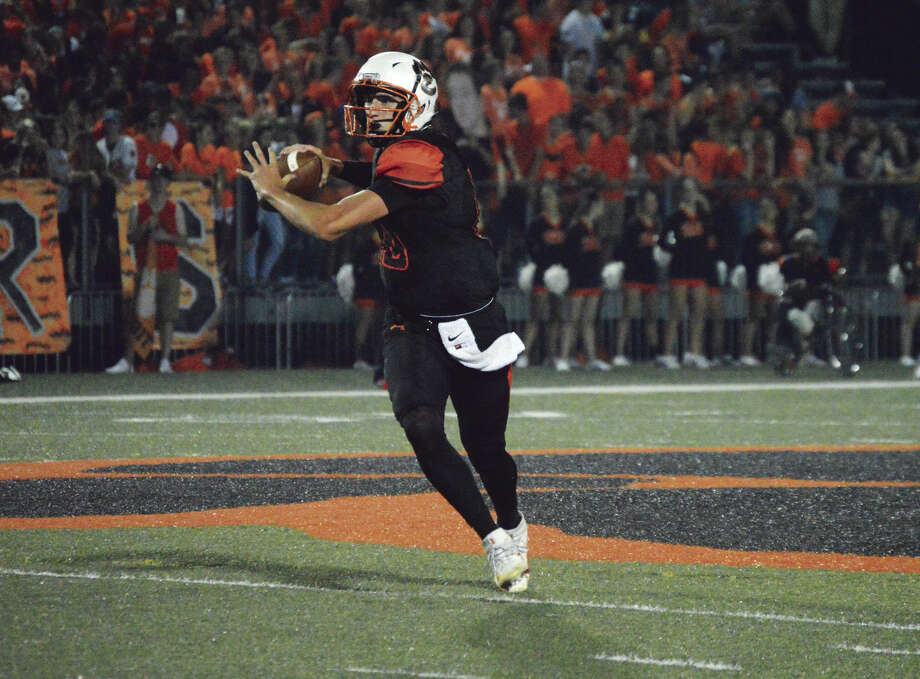 EHS quarterback Brenden Dickmann runs out of the pocket and looks for an open receiver.