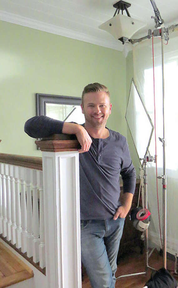 "Matt Muenster, the host of ""Bath Crashers"" on HGTV, in the foyer of the Leclaire house used to film new commercials for Ameren Illinois."
