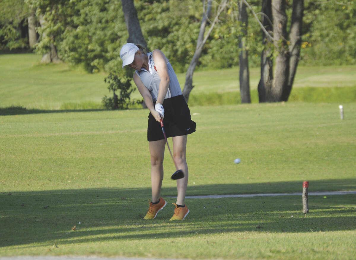 Edwardsville senior Kayla Weinacht hits her tee shot on the ninth of the east nine at Oak Brook Golf Club on Wednesday.