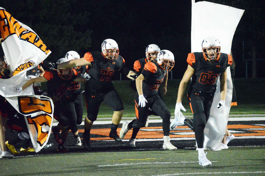 The Edwardsville Tigers take the field at the District 7 Sports Complex prior to their game against Rock Island on Friday. The Tigers will take on the Collinsville Kahoks on the road in Week 3.