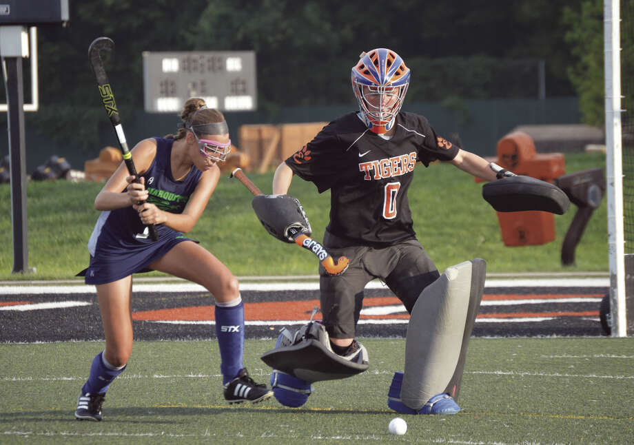 Edwardsville goalie Sarah Blume kicks a ball away from Marquette shooter Rebecca Croon during the fourth round of 1v1s.
