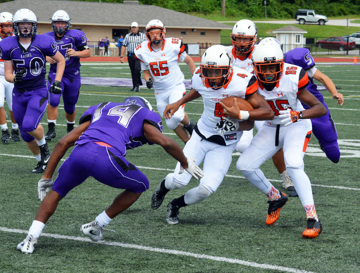 Edwardsville quarterback Kendall Abdur-Rahman (No. 4) looks to avoid a tackle late in the fourth quarter.